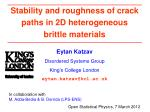 Stability and roughness of crack paths in 2D heterogeneous brittle materials